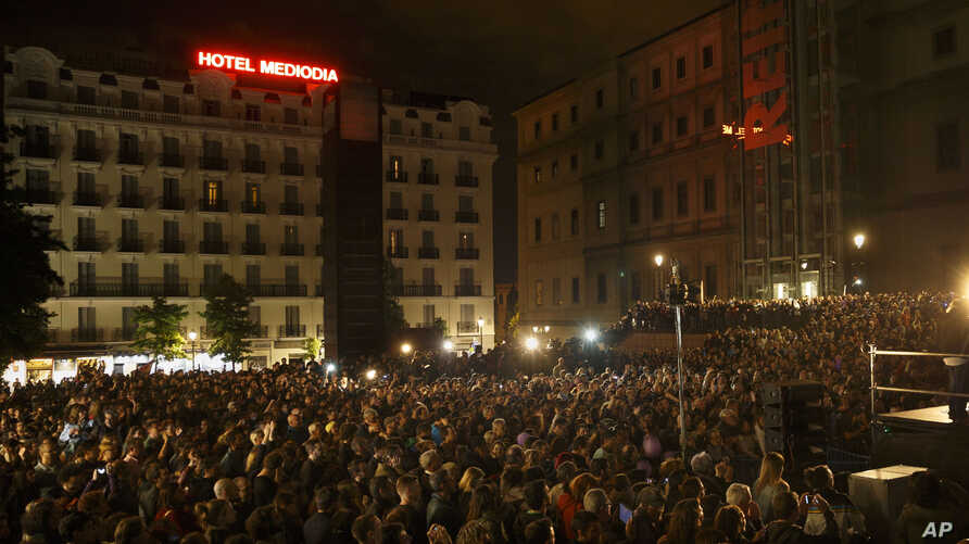 People attend a speech by Pablo Iglesias, leader of the Podemos (We Can) party celebrating the party results after the elections and in support of local candidate for Ahora Madrid (Madrid Now) party in Madrid, Spain, Sunday, May 24, 2015.