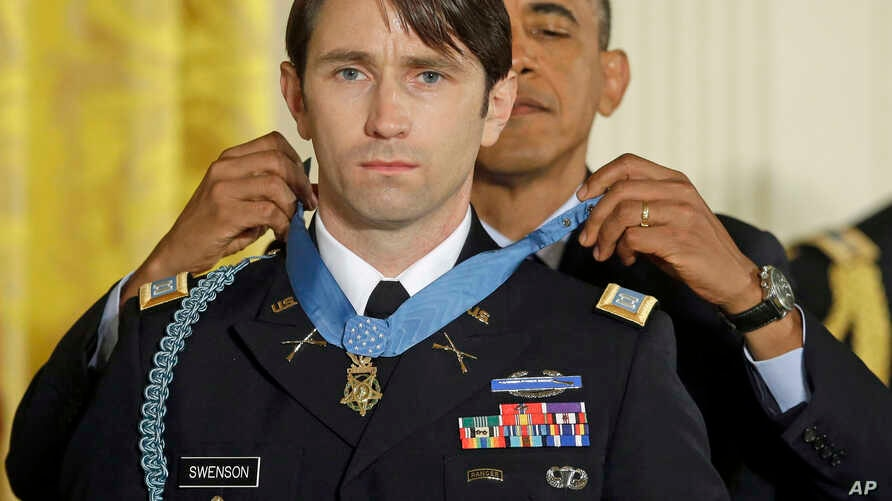 President Barack Obama awards the Medal of Honor to former Army Capt. William D. Swenson in the East Room at the White House, Oct. 15, 2013.