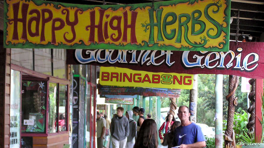 Shop signs along the main street of Australia's hippy capital Nimbin on April 12 promote the hippy way of life, which includes smoking marijuana. Australia hopes to soon export of medicinal marijuana and corner a piece of the lucrative world market.