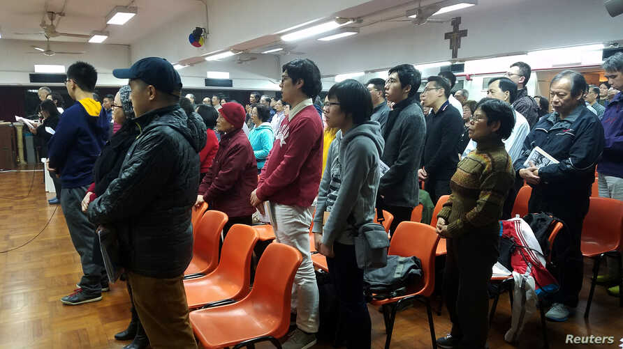 About 200 Catholics attend a prayer meeting for the Chinese Church after news emerge that Beijing and the Vatican have reached a deal on bishop appointments, in Hong Kong, China, Feb. 12, 2018.