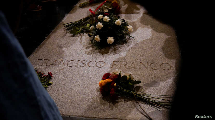 Flowers lie on the tomb of Spanish dictator Francisco Franco at El Valle de los Caidos (The Valley of the Fallen), the giant mausoleum holding the remains of Franco, in San Lorenzo de El Escorial, outside Madrid, Spain, Aug. 24, 2018.