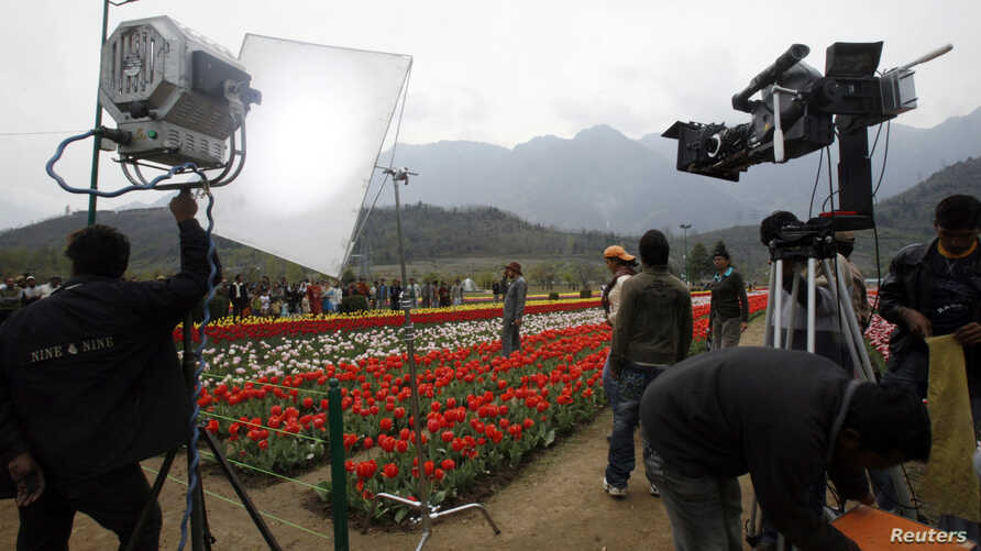 "A Bollywood film unit prepares to shoot a scene of Hindi movie ""Sadiyan"" (Centuries) inside Kashmir's tulip garden in Srinagar April 9, 2008."
