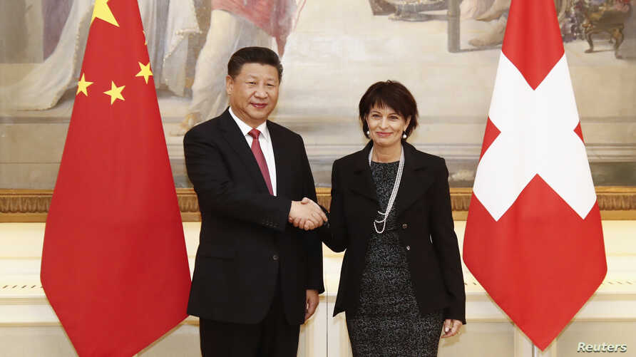 Swiss President Doris Leuthard and China's President Xi Jinping shake hands prior to the official talks in Bern, Switzerland, Jan. 16 2017.