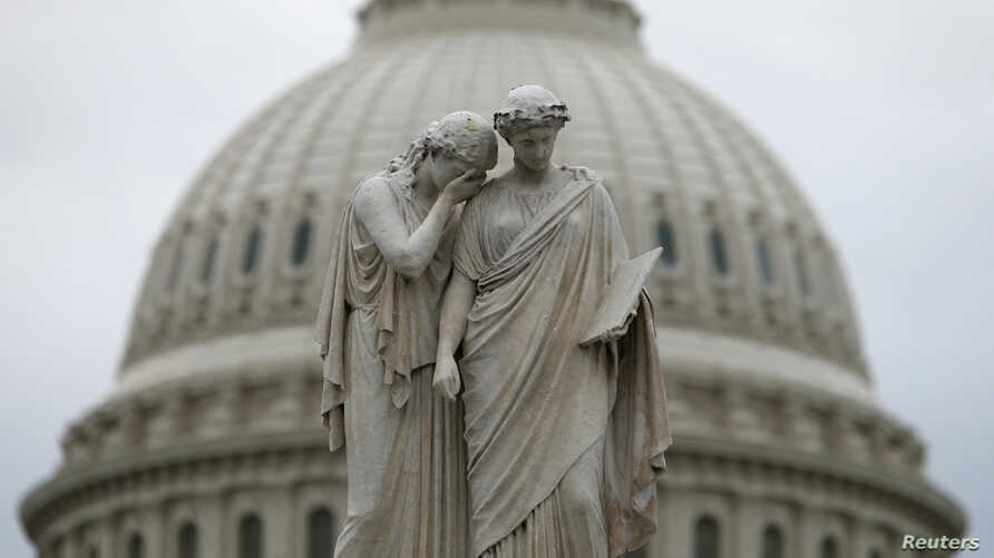 The statue of Grief and History stands in front of the U.S. Capitol Dome in Washington, Oct. 16, 2013.