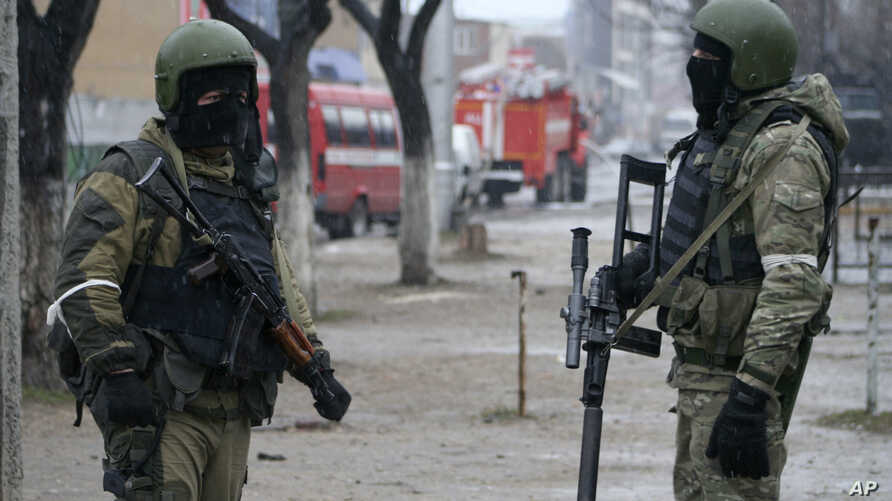 FILE - Russian special forces soldiers wear masks during an anti-terrorist operation in Makhachkala, Dagestan, Russia, Jan. 20, 2014. Dagestan province in the North Caucasus has been feeding hundreds of fighters to the Islamic State in Syria, officia