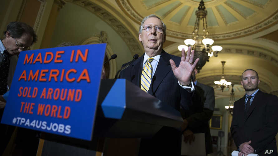Senate Majority Leader Mitch McConnell of Ky. speaks during a news conference on Capitol Hill in Washington, May 19, 2015, with small business owners to discuss the Trade Promotion Authority bill.