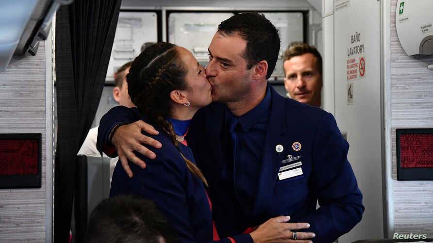 Crew members Paula Podest and Carlos Ciufffardi kiss after being married on board by Pope Francis during the flight between Santiago and the northern city of Iquique, Jan. 18, 2018.