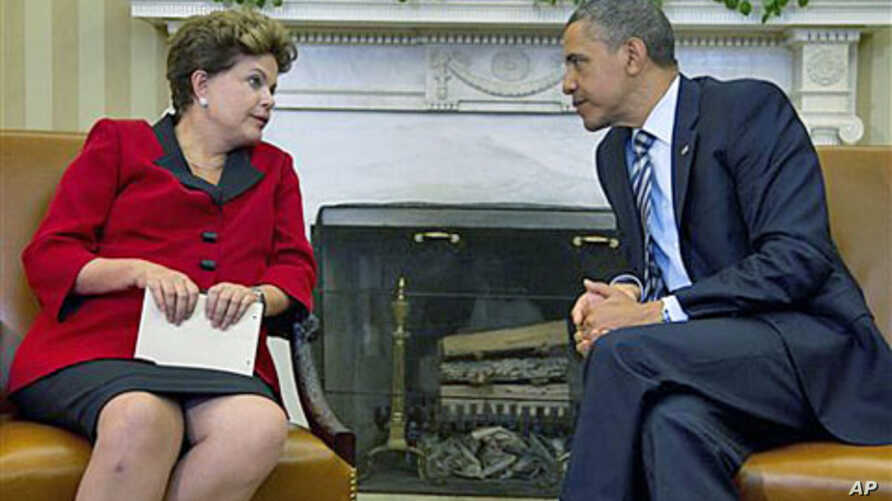 President Barack Obama meets Brazil's President Dilma Rousseff in the Oval Office of the White House in Washington, April 9, 2012.