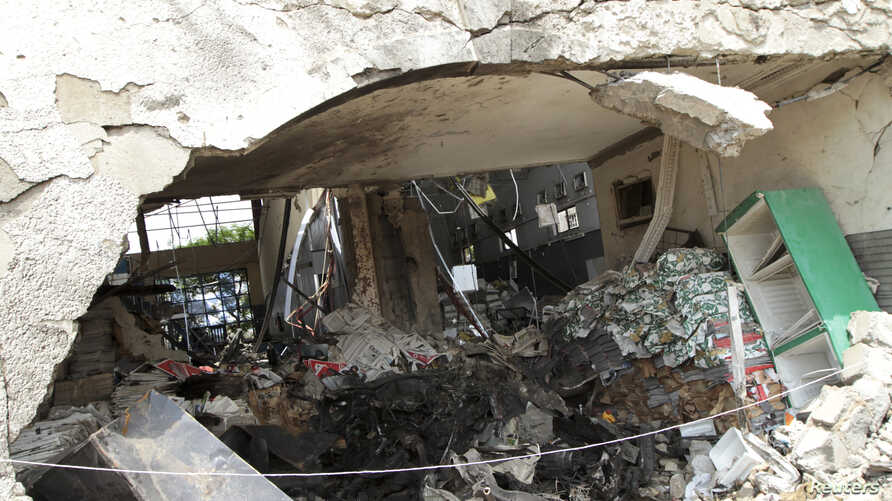 Burnt newspaper copies are seen in the rubble of a destroyed ThisDay newspaper building in Abuja April 28, 2012.