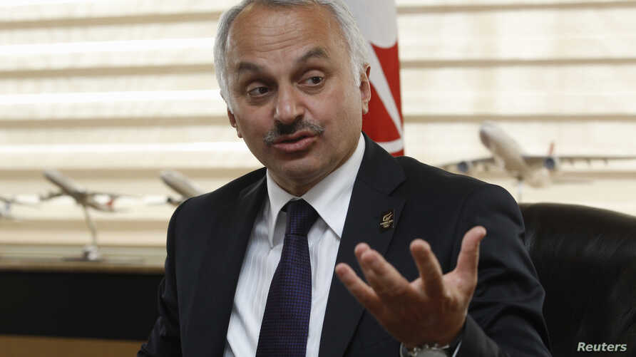 Turkish Airlines Chief Executive Officer Temel Kotil gestures during an interview with Reuters in Istanbul, April 17, 2013.