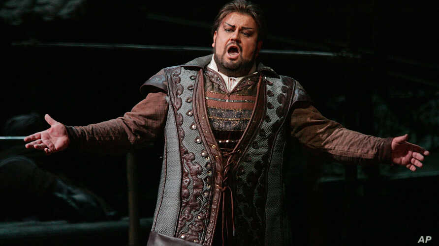 "FILE - Johan Botha sings the role of Calaf during a dress rehearsal of Giacomo Puccini's opera ""Turandot"" at the Metropolitan Opera in New York."