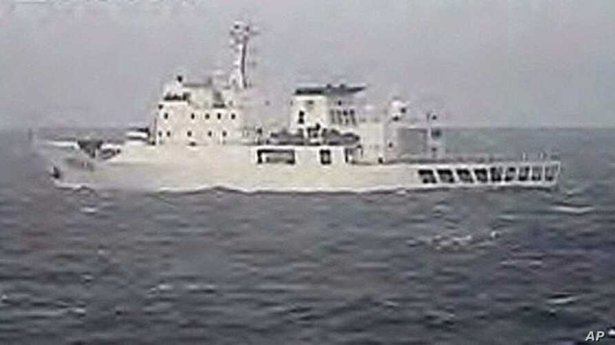 """Photo taken by Japanese Coast Guard shows Chinese fisheries patrol ship """"Yuzheng 310"""" sailing near the disputed islands (2010 File)"""