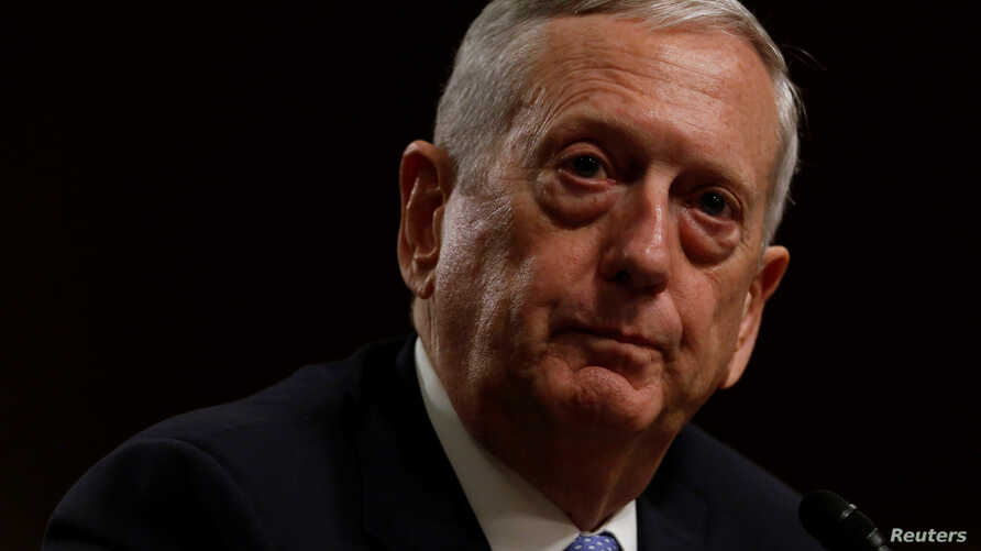 """FILE - Retired U.S. Marine Corps General James Mattis, shown at his confirmation hearing before the Senate Armed Services Committee on Jan. 12, 2017, told Defense Department staff and service members worldwide that they represent """"an America that rem"""