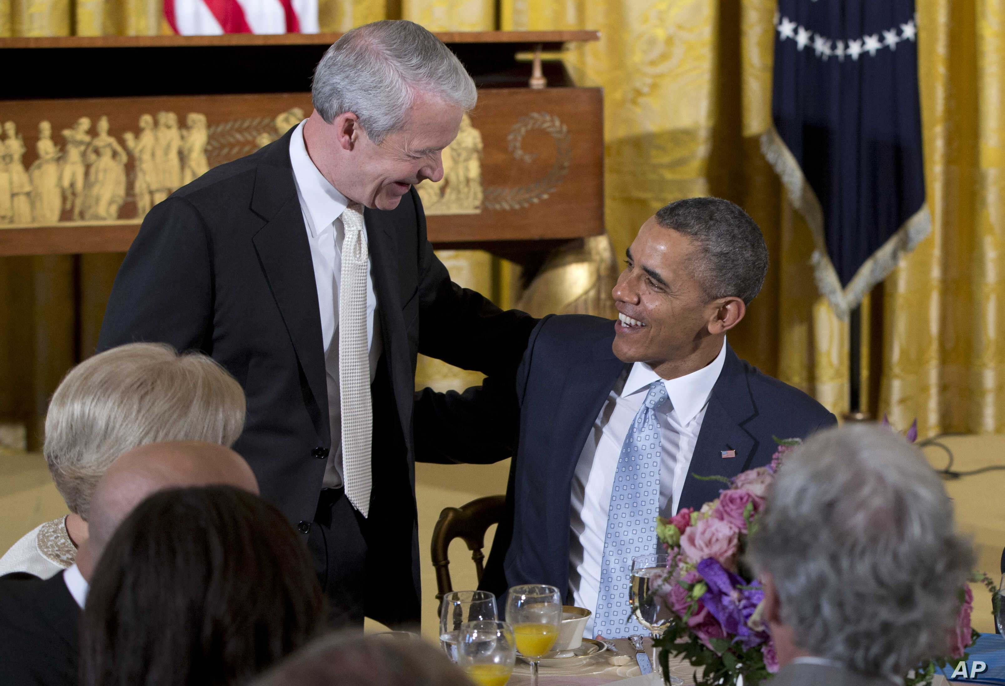 FILE - President Barack Obama greets the Rev. Joel Hunter, senior pastor of Northland, A Church Distributed, in Longwood, Fla., during the Easter Prayer Breakfast in the East Room of the White House in Washington.