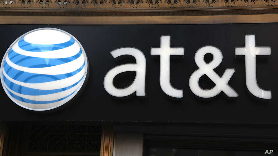 FILE - AT&T sign at store in New York.