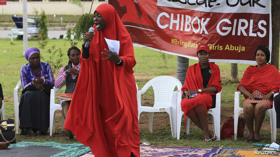 "A member of the Abuja ""Bring Back Our Girls"" protest group addresses a sit-in demonstration organized by the group at the Unity Fountain in Abuja, Nigeria, June 23, 2014."