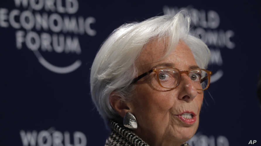 Christine Lagarde, Managing Director of the International Monetary Fund (IMF), addresses a news conference on the eve of the World Economic Forum, WEF, in Davos, Jan. 22, 2018.