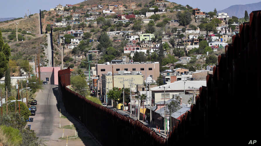 The international border cuts through Nogales, Sonora, Mexico, right, and Nogales, Arizona, as seen April 9, 2018, from Nogales.