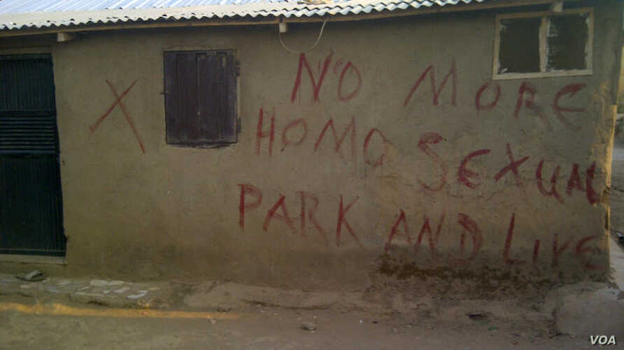 Before they destroy a building in Nigeria, authorities mark the building with a red 'X' and write a few words.  Taken in mid-February by a rights activist in Abuja, these are homes that been marked similarly by neighbors, warning gay people to leave
