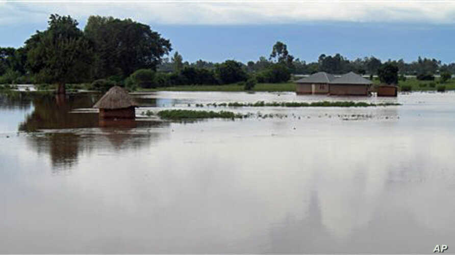 Homes flooded by water after the river Sondu Miriu burst it's banks in southern Nyanza , Kenya, April 29, 2012.