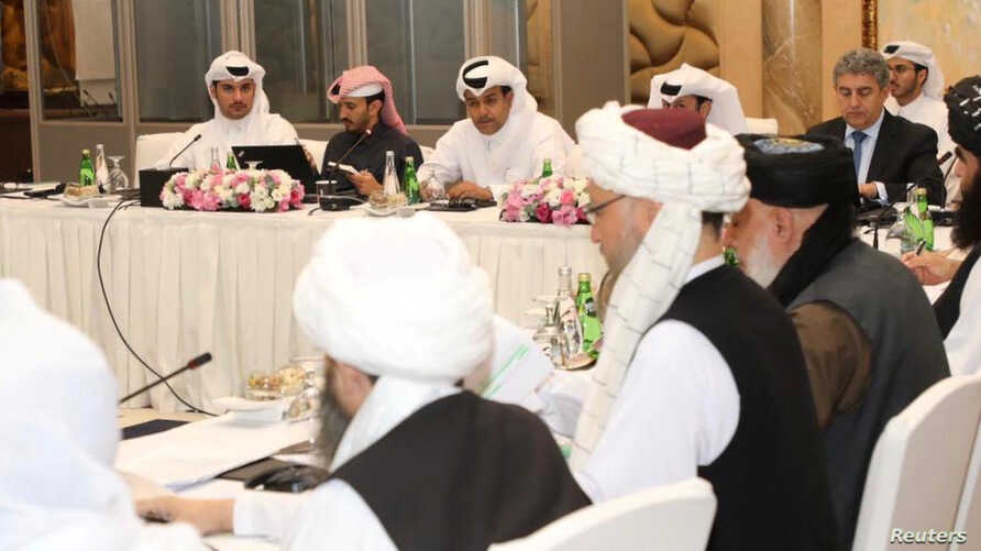 FILE - Undated handout picture of US, Taliban, and Qatar officials during a meeting for peace talks in Doha, Qatar. (Qatari Foreign Ministry)