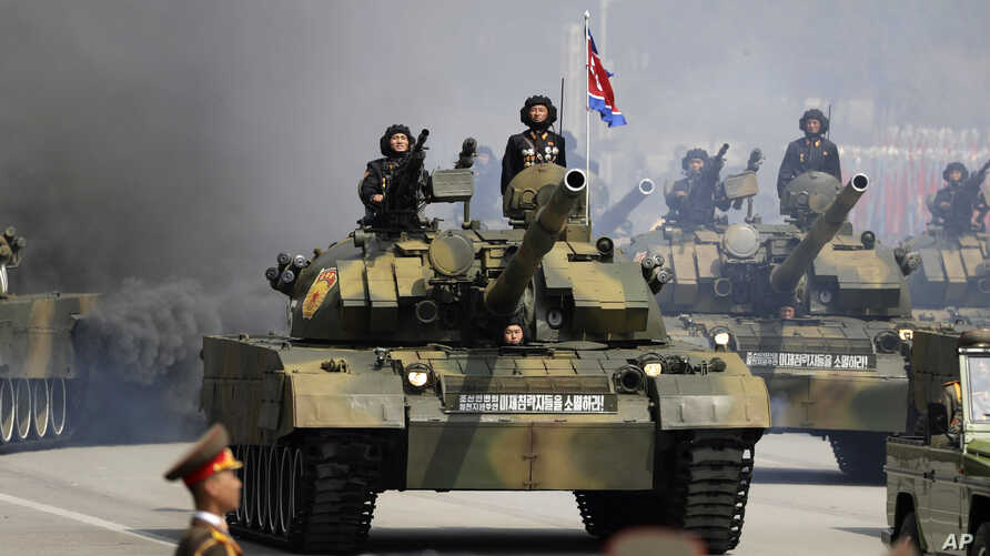 FILE - Soldiers in tanks are paraded across Kim Il Sung Square during a military parade, April 15, 2017, in Pyongyang, North Korea. The United Nations is investigating at least seven African countries accused of receiving military assistance from Nor