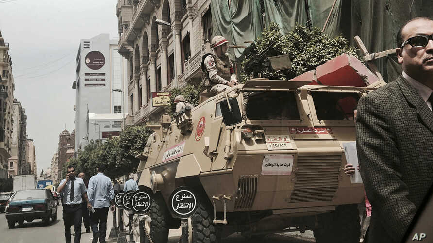 Soldiers guard a street near a church in downtown Cairo, Egypt, April 10, 2017, following Palm Sunday bombings in churches in Tanta and Alexandria that killed 45 Coptic Christians.