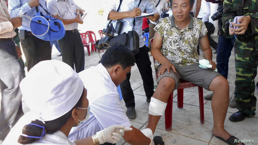 Caption: After his boat allegedly was rammed and sunk, an unidentified Vietnamese fisherman receives medical treatment on Vietnam's Ly Son island on May 29, 2014.