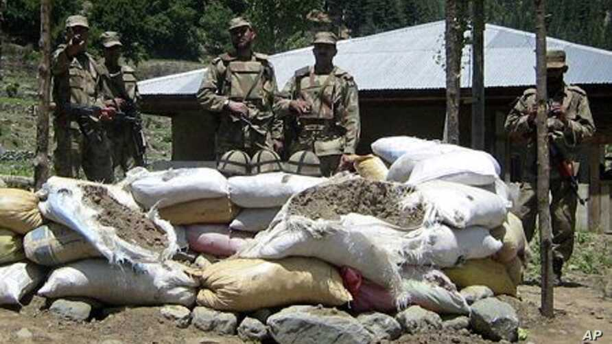 Soldiers stand near a checkpost which was attacked by militants in Upper Dir, along Pakistan's border with Afghanistan (File Photo - June 3, 2011).