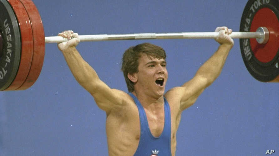 Turkey's Naim Suleymanoglu, seen in this 1988 file photo, died Saturday, Nov. 18, 2017. He was considered one of the sport's greatest athletes and earned his nickname for his strength and diminutive size.