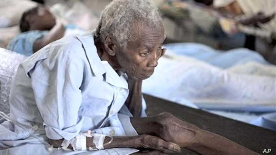 A woman suffering from cholera symptoms is treated at the St. Nicholas hospital in Saint Marc, Haiti, 8  Nov.  2010.