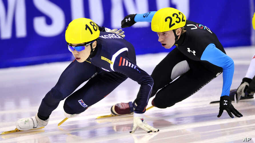 FILE - South Korea's Noh Jin-Kyu, left, speeds on track during the men's 1500 meters quarterfinal at the Short Track World Cup, in Turin, Italy.