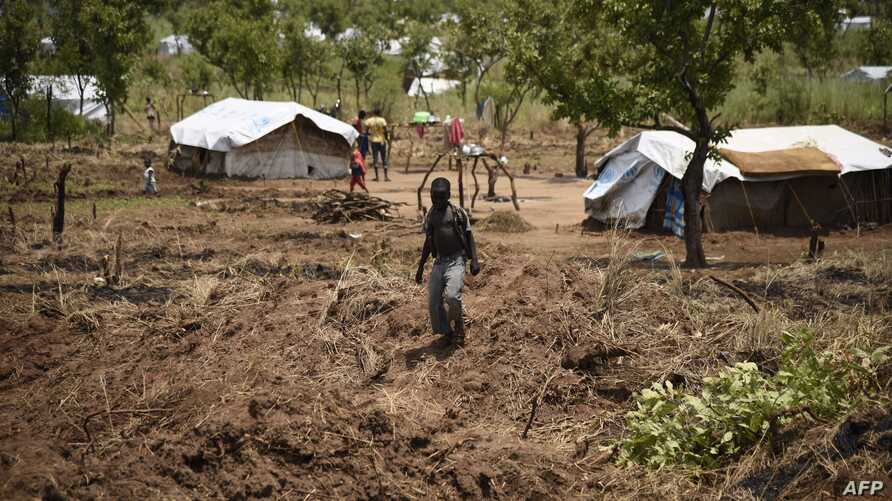 FILE - A young South Sudanese refugee walks in the Pagirinya refugee settlement in Adjumani, north of Kampala, Uganda, Aug. 29, 2016.