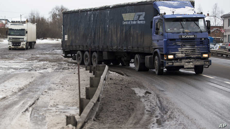 A truck move out from a parking area about 35 kilometers (21,75 miles) south of Moscow, Dec. 3, 2015.