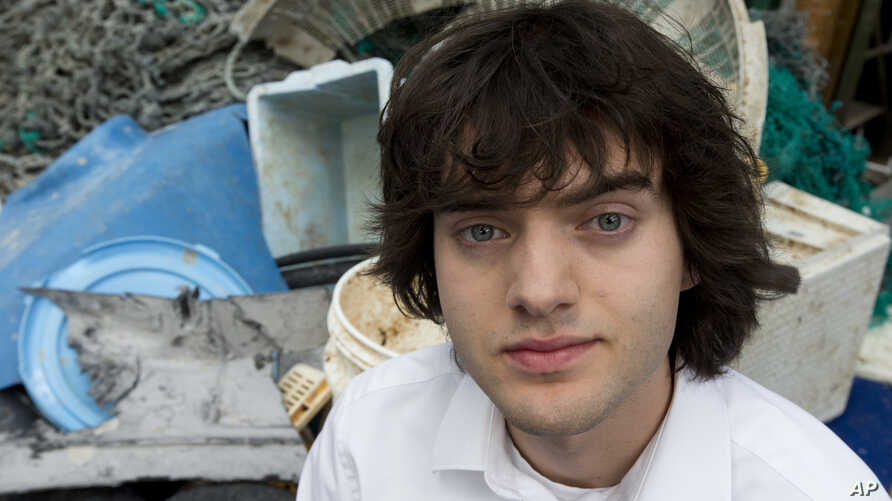 Dutch university dropout Boyan Slat, who founded the The Ocean Cleanup, poses for a portrait next to a pile of plastic garbage prior to a press presentation in Utrecht, Netherlands, May 11, 2017.