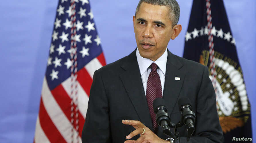 U.S. President Barack Obama answers a question about the situation in Ukraine in Washington, D.C. March 4, 2014.