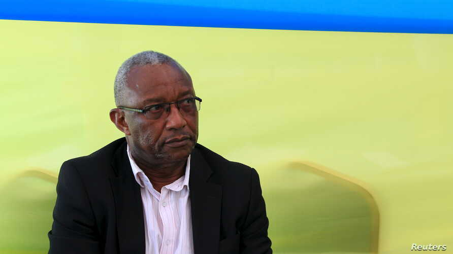 Kalisa Mbanda, Rwanda national electoral commission chairman, watches as votes are being counted at Amahoro polling station soon after polling closed in Rwanda's capital Kigali, Dec. 18, 2015.