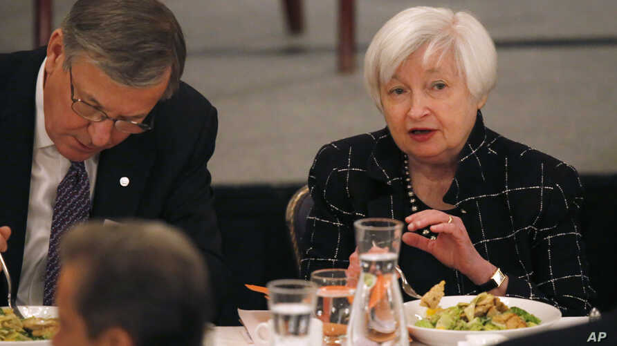 Federal Reserve Chair Janet Yellen, right, talks with Christopher B. Begy, CEO of BMO Financial Group, before her address to the Executives' Club of Chicago, March 3, 2017, in Chicago.