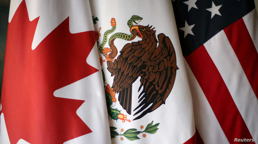 FILE - From left, the flags of Canada, Mexico and the United States are pictured at NAFTA talks in Mexico City, Nov. 19, 2017.