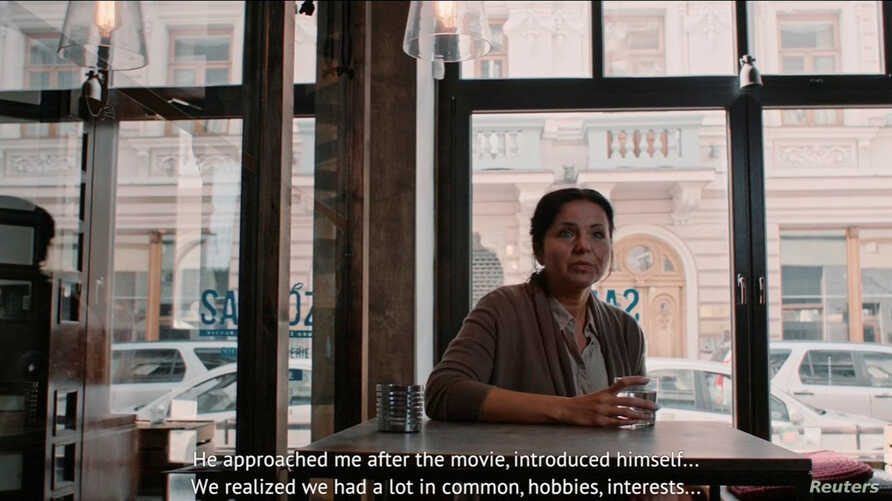 """An actor reading a """"testimonial"""" about a suspiciously friendly stranger is seen in this image taken from a TV ad by Lithuanian State Security Department, Nov. 30, 2016."""