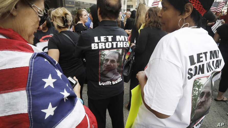 Iraqis and supporters rally outside the Theodore Levin United States Courthouse, June 21, 2017, in Detroit.