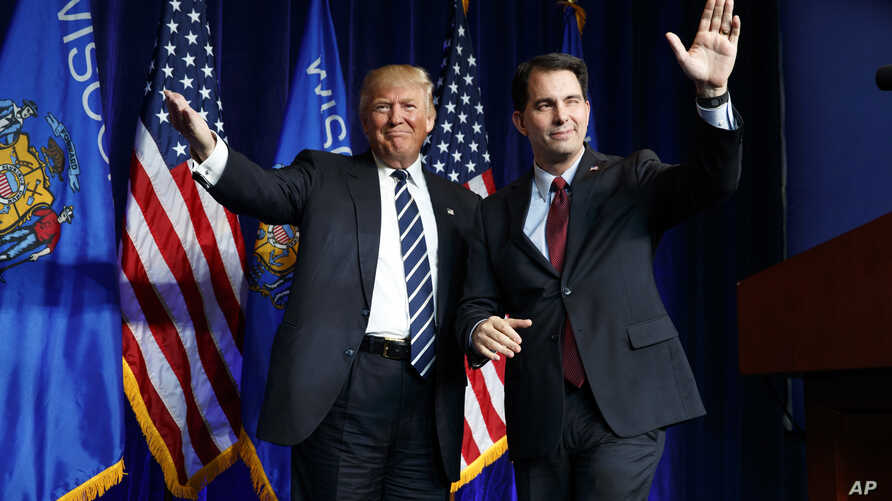 FILE - Governor Scott Walker (R) winks as he walks offstage after introducing then Republican presidential candidate Donald Trump during a campaign rally at the University of Wisconsin Eau Claire, Nov. 1, 2016, in Eau Claire, Wisconsin.