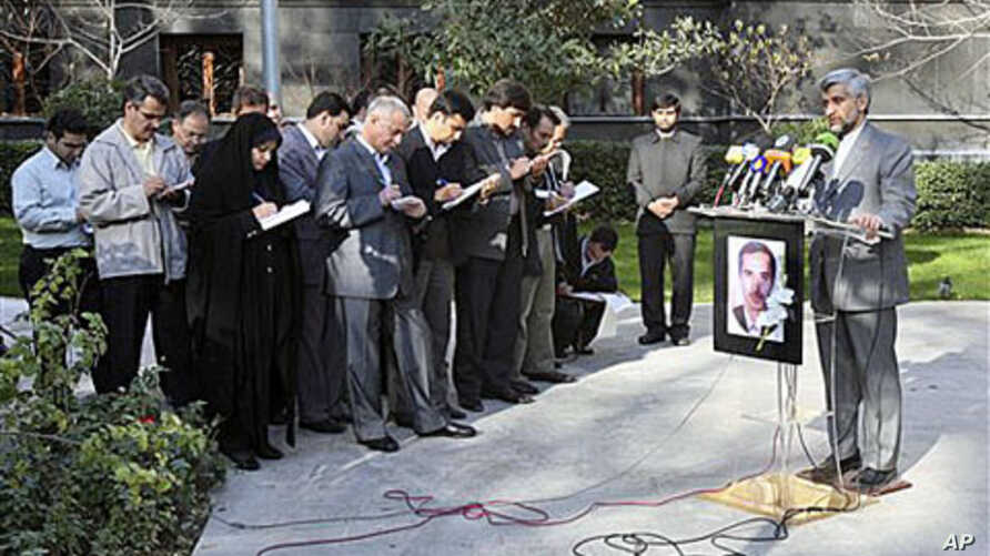Iran's top nuclear negotiator, Saeed Jalili, right, speaks with media in Tehran, Iran, saying there will be no progress in upcoming nuclear talks with the world powers unless Iran's rights are respected, Dec 4, 2010. A picture of Majid Shahriari, a p