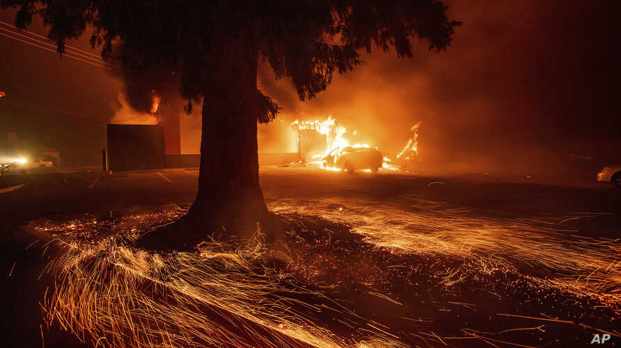Flames consume a Kentucky Fried Chicken as the Camp Fire tears through Paradise, Calif., on Nov. 8, 2018.