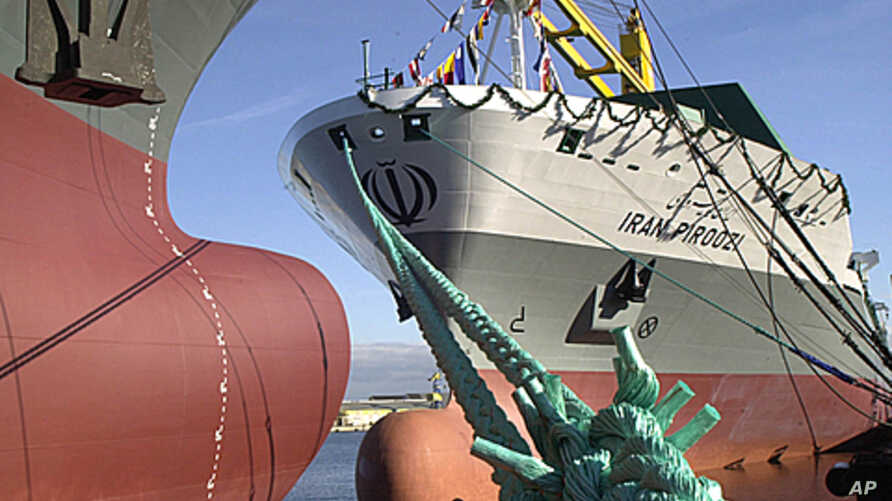 """The container vessel """"IRAN PIROOZI"""" anchors at the quay of Aker MTW Shipyard in Wismar, northern Germany, after namegiving ceremony ( 2003 file photo)."""