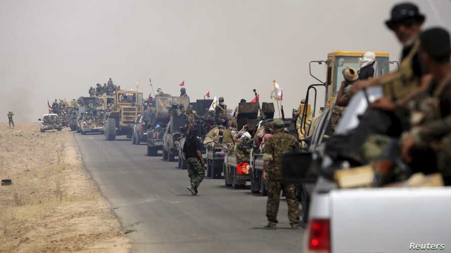 Shi'ite paramilitaries riding military vehicles travel from Lake Tharthar toward Ramadi to fight against Islamic state militants, west of Samarra, Iraq May 27, 2015. A campaign led by Shi'ite paramilitaries to drive Islamic State militants from Iraq'