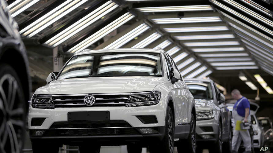 FILE - Volkswagen cars are pictured as they undergo a final quality control at the Volkswagen plant in Wolfsburg, Germany, March 8, 2018.
