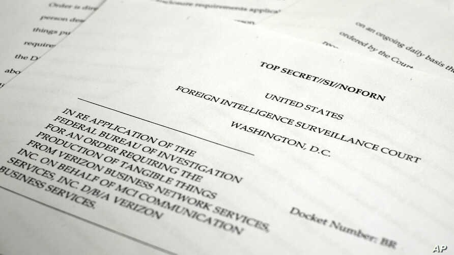 """A photo made June 6, 2013 in Washington shows a copy of the  U.S. Foreign Intelligence Surveillance Court order requiring Verizon on an """"ongoing, daily basis"""" to give the National Security Administration (NSA) information on all landline and mobile t"""