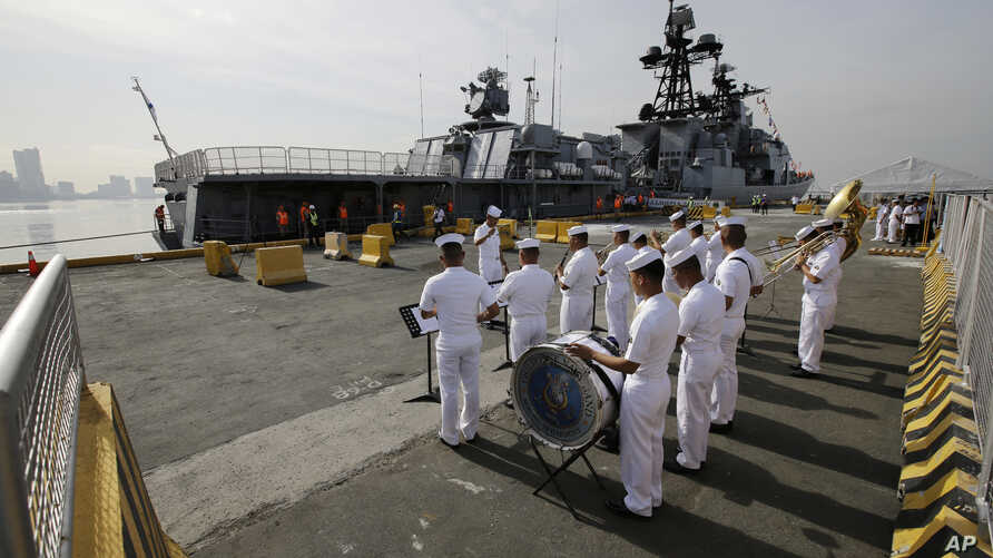 A Philippine Navy Band plays as the Russian Navy vessel Admiral Tributs, a large anti-submarine ship, docks at Manila's pier, Philippines, Jan. 3, 2017. Two Russian Navy Vessels are in the country for a goodwill visit until Jan. 7.