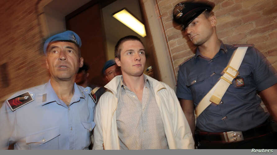 FILE - Raffaele Sollecito (C) arrives in court for his appeal trial session in Perugia, Sept. 26, 2011.